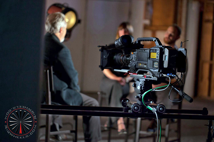 Large camera dolly kit being used for tv interview