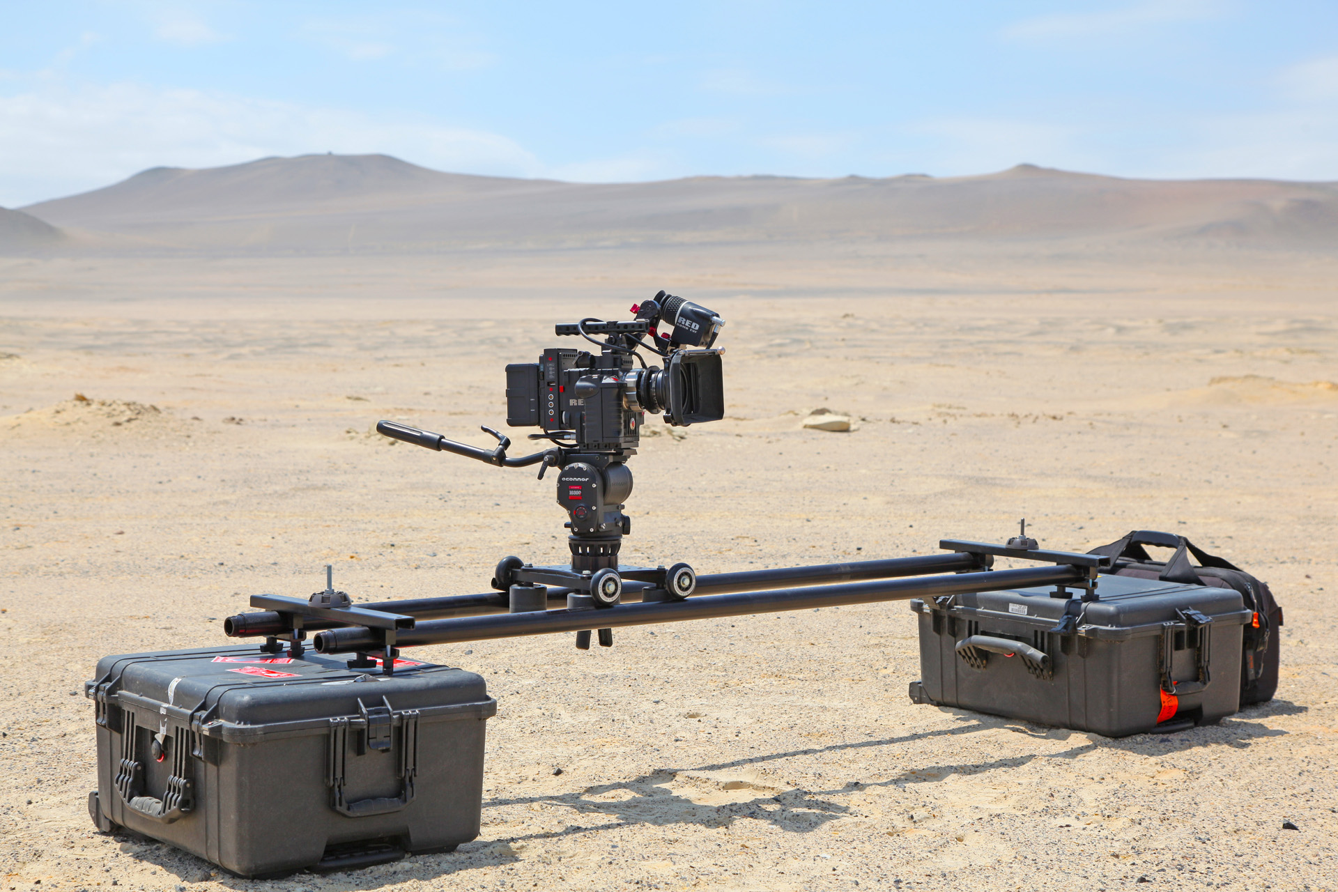 Slider dolly for cinematography and filmmaking