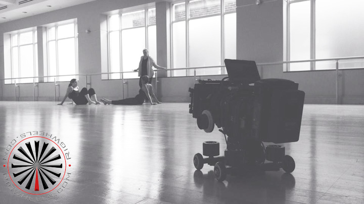 Low angle camera dolly kit being used on a dance floor in a studio